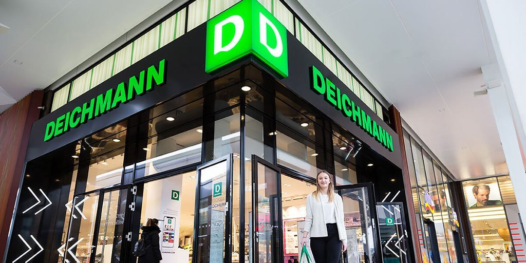 Site selection: The storefront of shoe retailer Deichmann with people walking in and out.